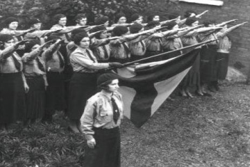 female blueshirts making the fascist salute