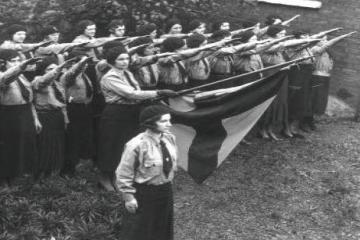 female blueshirts making the fascist salute