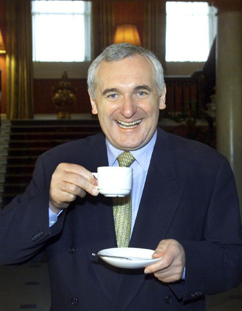 Pic of Bertie Ahern drinking tea. Smiling. Like a shite.