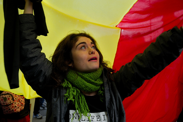 Woman holding a flag at demonstration for a republic