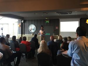 "Mandate National Coordinator Brian Forbes speaks at an ""Organise for €15"" meeting in Bray. Credit: Mandate / Facebook."